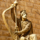 Which king is depicted with a harp?