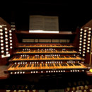 Before the 19th century, how many people were needed to make pipe organ play?