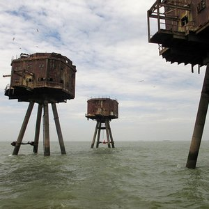 These rusting sea forts were built near a certain capital city. Which one?