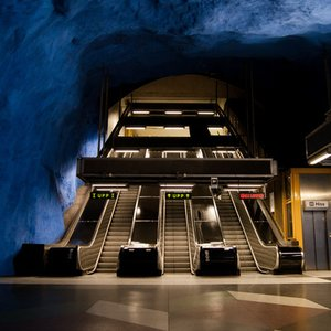 Which city is known for its cave-like subway stations?