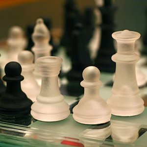 What happens if a chess player wants to promote his pawn to a queen (after reaching the eighth rank), but his queen is still on the chessboard?