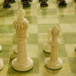 Which piece may a chess player use for his initial move?