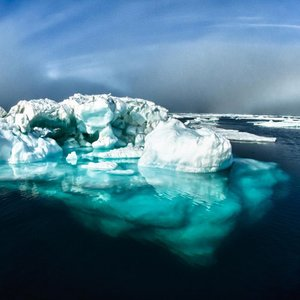What sound can be heard when approaching an iceberg?