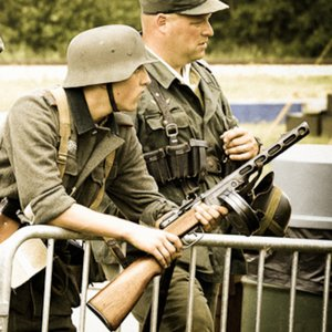 There is something wrong here. The German soldier holds a non-German gun. Where were such guns made?