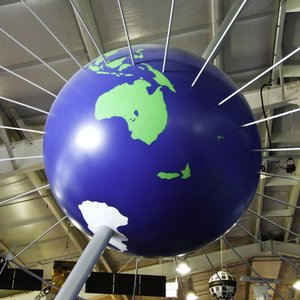 If Earth's radius was larger by 1 meter, how much longer would its equator be?