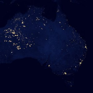 In 2012, NASA published famous 'Black Marble' night lights images. What are the lights in the uninhabited regions of western Australia caused by?