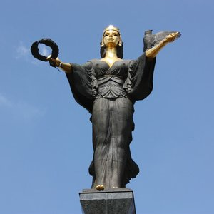 In which European city was this photo taken? It depicts eight meter tall statue of the city's patron.