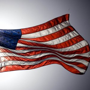 What do red-white stripes represent on the USA flag?
