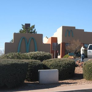 Which state in the United States has a city that has their McDonald's sign turquoise?