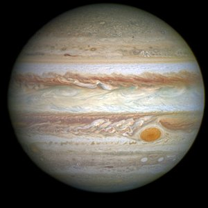 How many times is Jupiter's volume larger than Earth's volume?