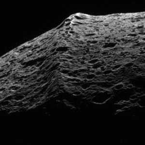 Which of Saturn's natural satellites has such distinctive equatorial ridge?