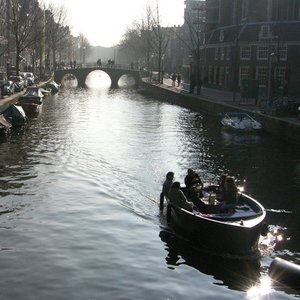 Which river flows through Amsterdam?