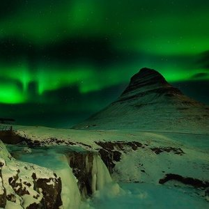 In which layer of the atmosphere the aurora is created?