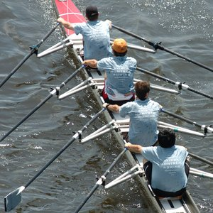 How does the crew of the coxless four steer?
