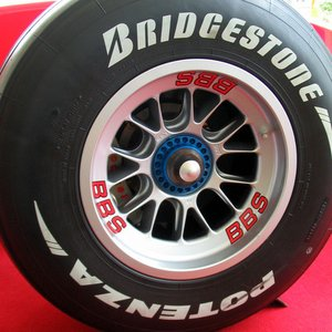 Where does the Bridgestone Corporation, maker of the Bridgestone tires, come from?