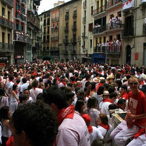 Which town in Spain is world famous for its running-of-the-bulls festival?