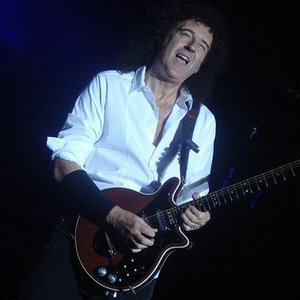 What is Brian May, the guitarist and songwriter of Queen, good at?