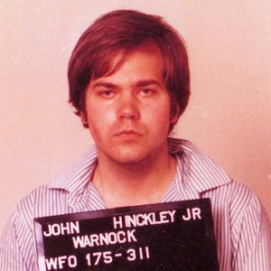 On March 30, 1981, US president Ronald Reagan and three others were shot and wounded by John Hinckley, Jr. What was his motive?