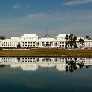 What was the reason to build Canberra for Australian capital, rather than selecting one of the existing large cities?