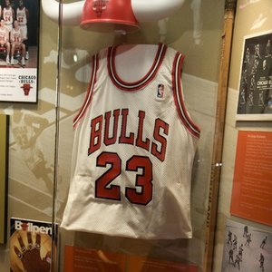 Which NBA team retired Michael Jordan's jersey number despite he never played for them?