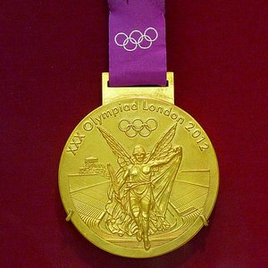 When and where was the idea of gold, silver and bronze medals for sport event competitors introduced?