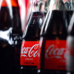 What is the main difference between Coca-Cola sold in the US, and the Coca-Cola sold in the EU?