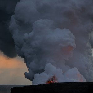 Which volcano is known as being one of the most active, but at the same one of the least violent in the world?