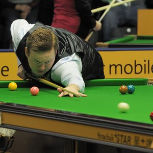 Which snooker player donates 100£ to a charity for every century break he makes in a competition match?